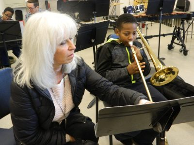 Joyce DiCamillo with Project Music student at band practice